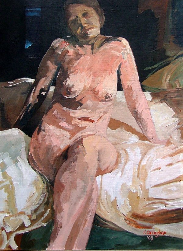 Mandy Green, seated on bed